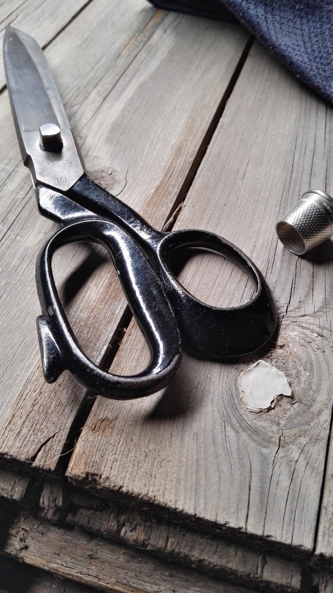 skillful fingers, making a tie, handrolling hem